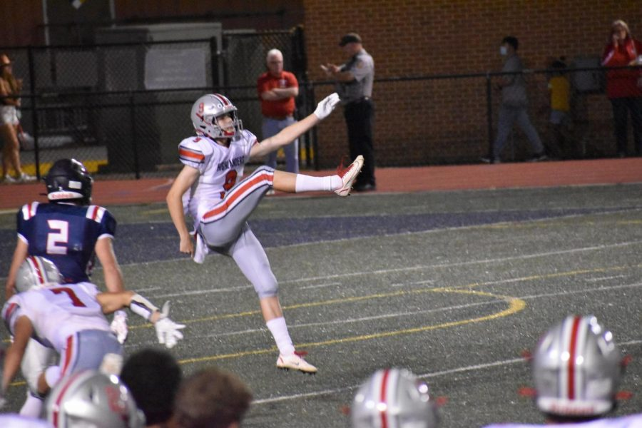 Punter Tyler Fontenot booms a punt from deep in his own territory.