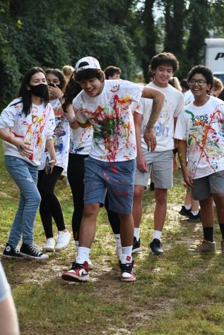 Gather Around - Students get together to paint the backs of their shirts.