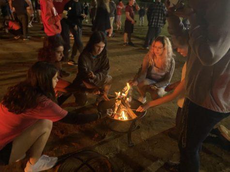 Students roast marshmallows at the beginning of the night.