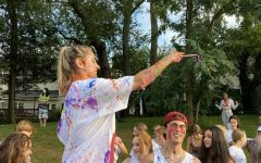 IN THE ACT- Senior Monica Molnar splatters paint at celebrate McLean. The seniors in leadership stood above other students and threw paint on them.