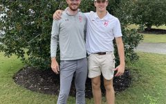 Cab Fooshe at the VHSL State Tournament with the McLean Varisty Golf Coach Ryan Abrams.