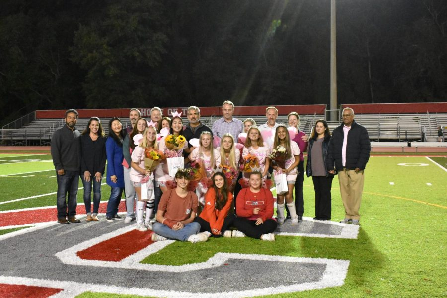 The seniors and their family members pose for photos. The pictures taken were posted online, including on the McLean High and McLean Athletics Instagram accounts.