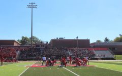 Football players act as chairs for an intense game of musical chairs between the classes.